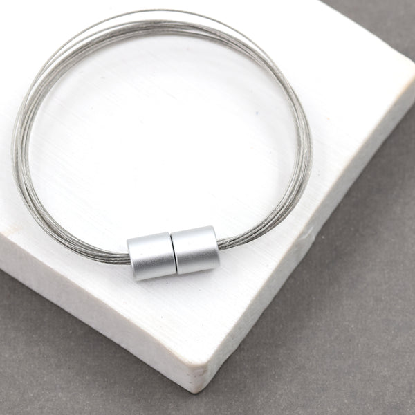 Multi wire contemporary bracelet with cylindrical magnetic