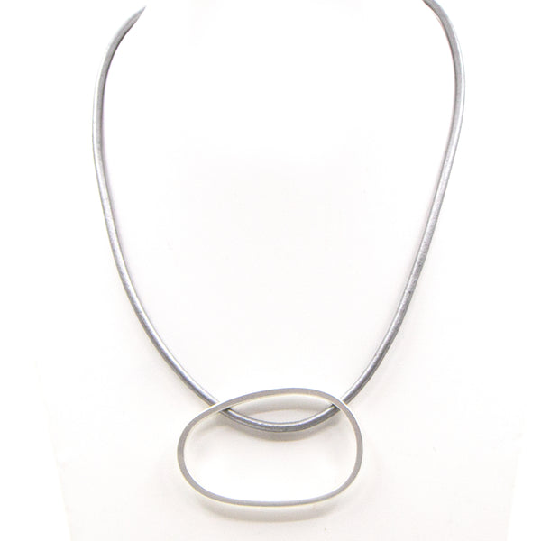 Open elongated circle pendant on short leather necklace
