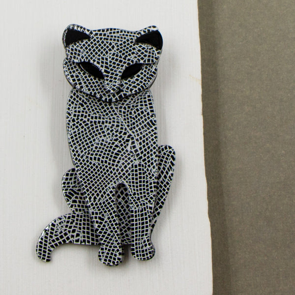 Black and white resin cat brooch