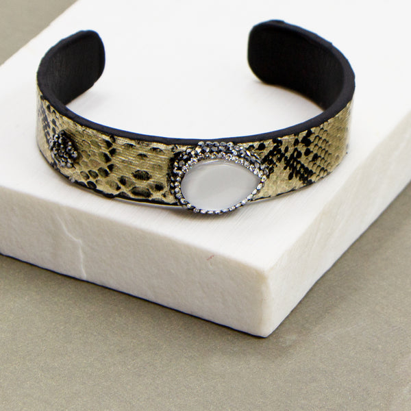 Slender open metallic cuff with crystal studded mother of pearl feature
