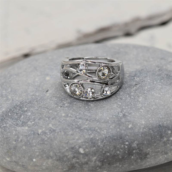 Stretchy rhodium ring with crystal stones