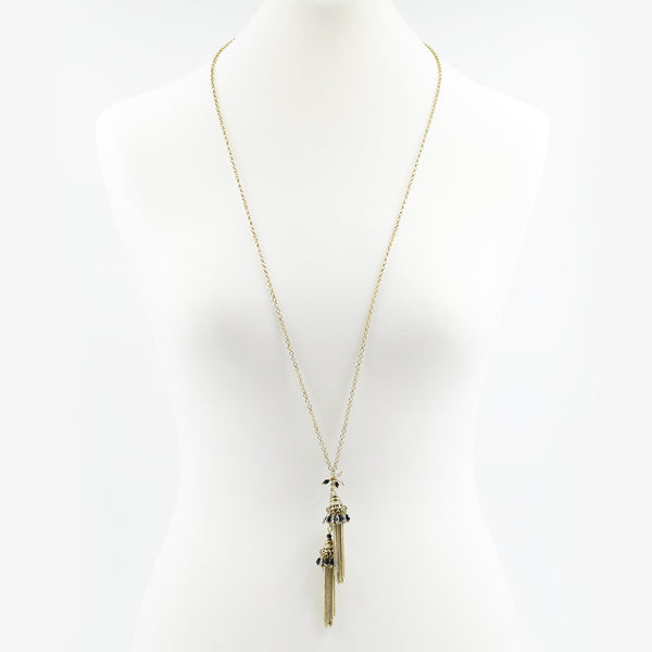 Long necklace with twin tassel pendants with crystals