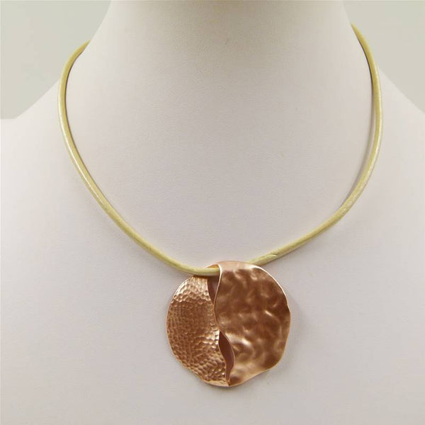 Textured circle pendant with cutout detail on short leather