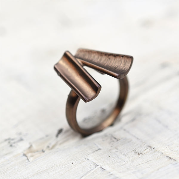 Geometric open tubes with mix texture finish ring