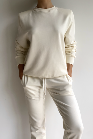 PARENTEZI PADDED SHOULDER CREWNECK SWEATER IN WHITE