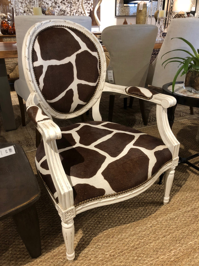 This stylish Sophie chair has an elegant white wood finish covered with a dark brown and white Giraffe Hide.