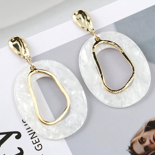 white and gold tone drop earrings