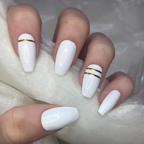 White and Gold Tape Coffins