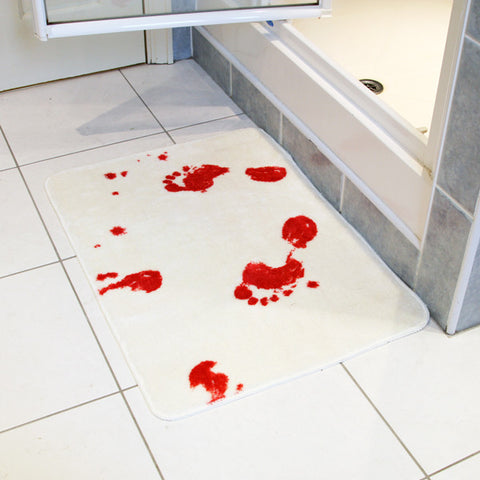 white bath shower mat with bloody footprints