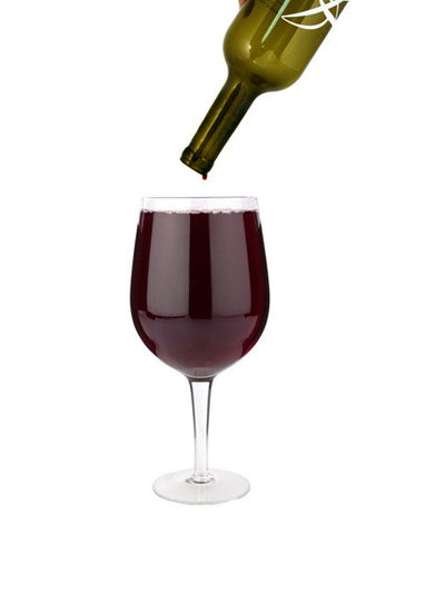 huge wine glass full bottle big white background
