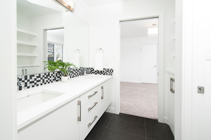 Black and white floating vanity with back splash