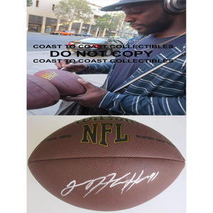 Lamarr Houston, Chicago Bears, Oakland Raiders, Texas Longhorns, Signed, Autographed, NFL Football, a COA with the Proof Photo of Lamarr Signing the Football Will Be Included