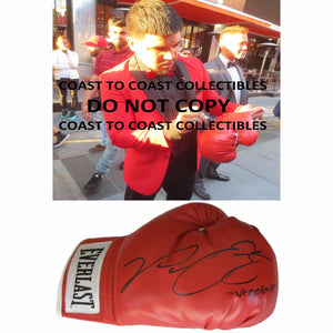 Victor Ortiz, WBC Boxing Champ, Signed, Autographed, Everlast Boxing Glove,The Glove Comes with a COA and Proof Photo of Victor Signing the Glove