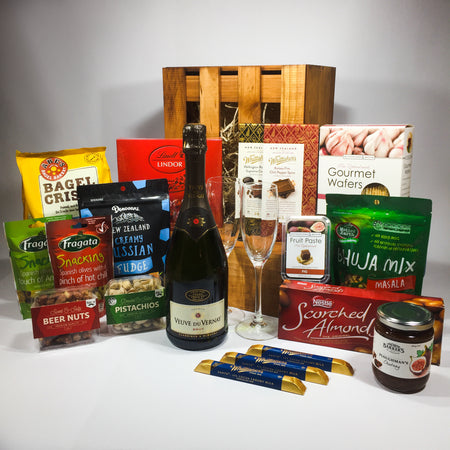 Wine and chocolates inside a wooden gift hamper