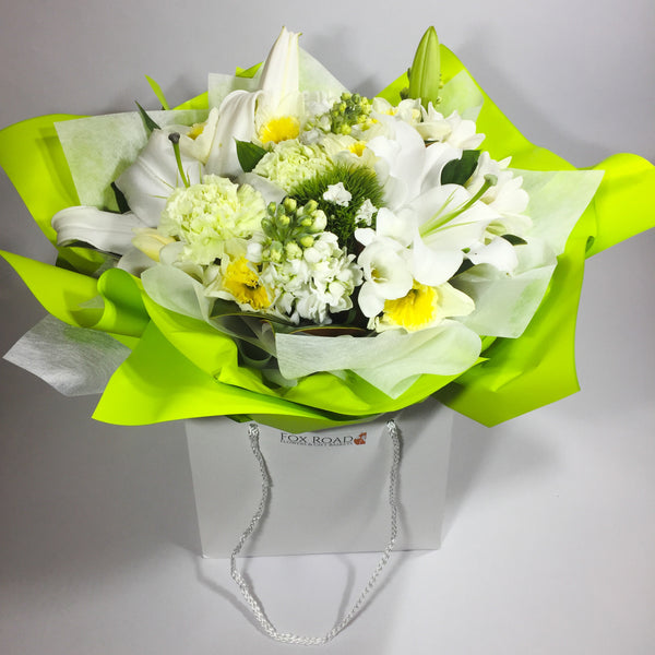 Lilies and white flowers for sympathy occasion