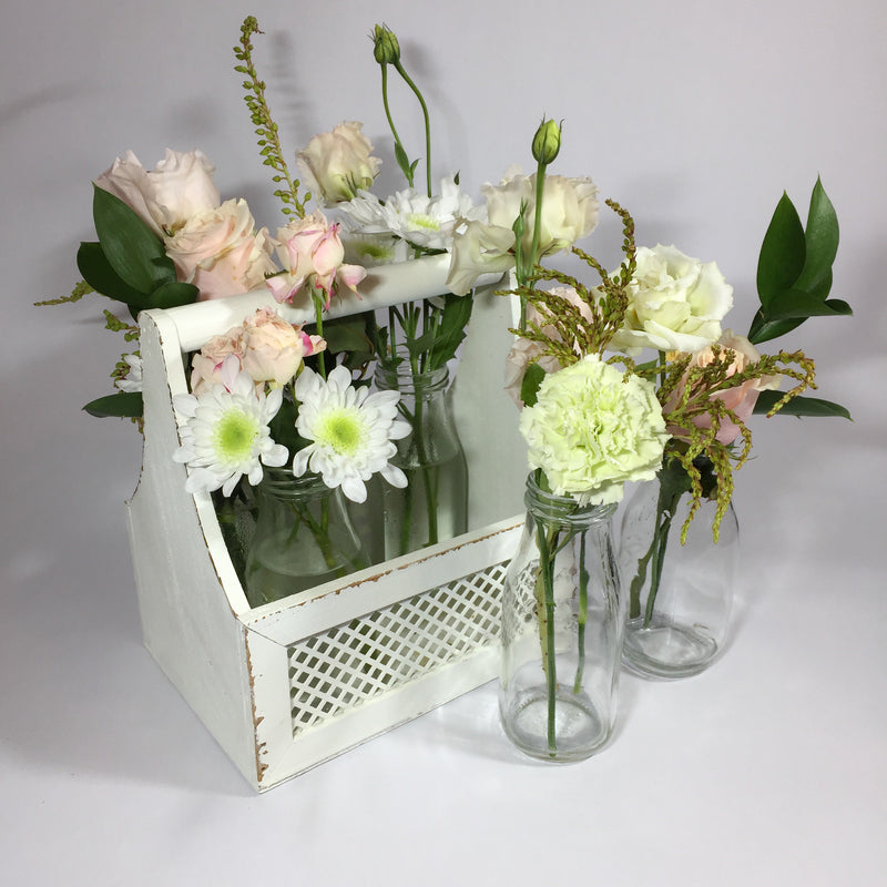 white spray chrysanthemums with milk bottles
