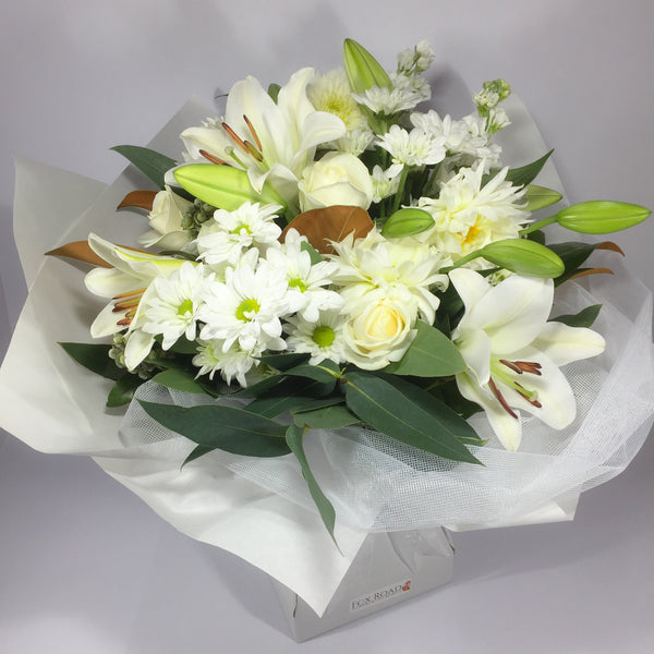 Roses and lilies in a flower gift box by local florist