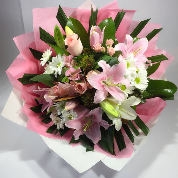 Lower Hutt rose and lily flowers being delivered to customer