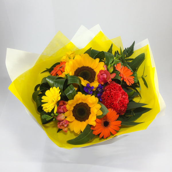 Sunflowers, Gerberas and Celosia Flowers in a Bouquet