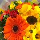 Orange and yellow flowers with florist