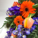 Close up of Porirua florist arranging gerberas