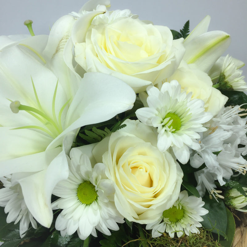 Close up of Lilies, Roses and Wellington florist
