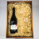 Roaring Meg Pinot Noir inside a Wooden Box and Wine Glasses