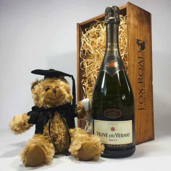 Graduation present with bear and champagne