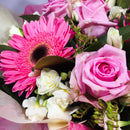 Close up of pink roses and other flowers
