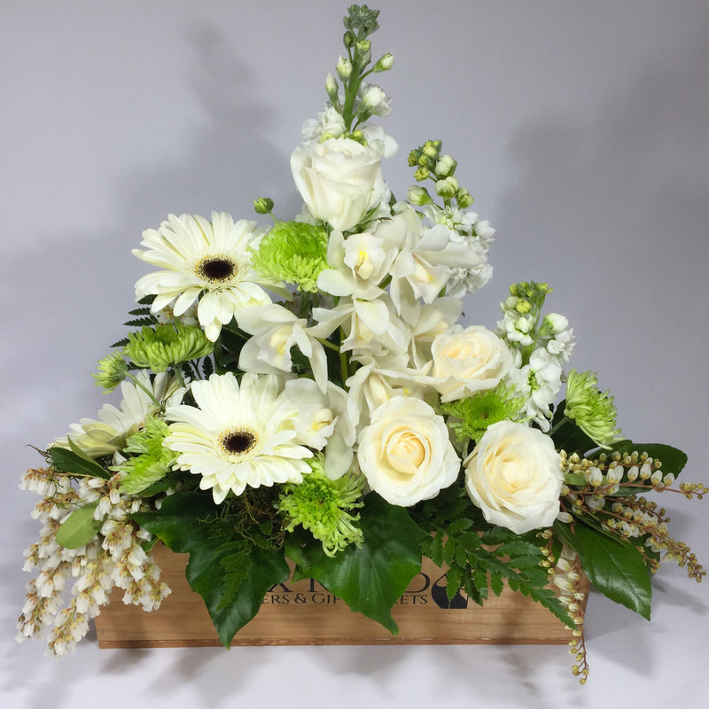 White delight floral arrangement with gerberas, roses, orchids, stock and spray chrysanthemums