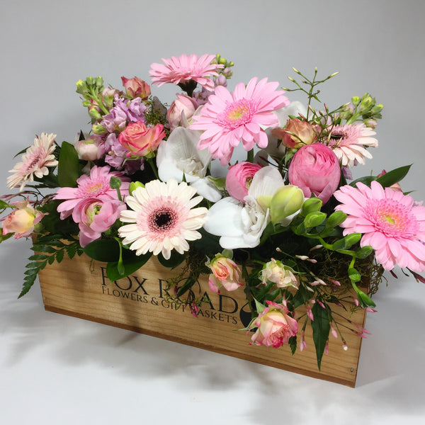 Soft flowers inside pamper gift basket