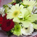Close up view of bouquet showing gerberas and roses