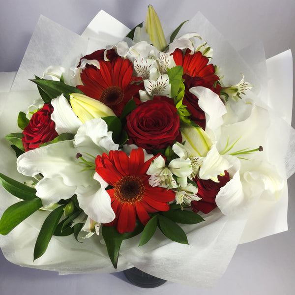 Starlight Bouquet filled with red and white flowers