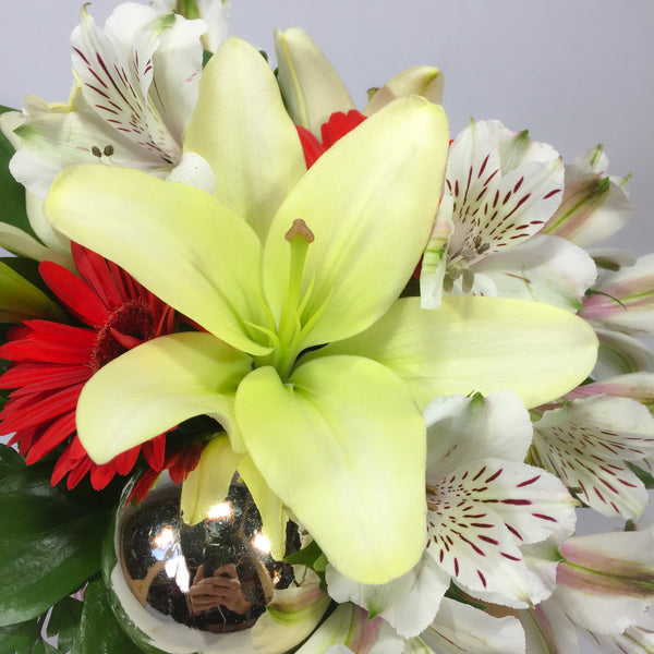 Lily, alstroemeria and roses prepared by Wellington florist