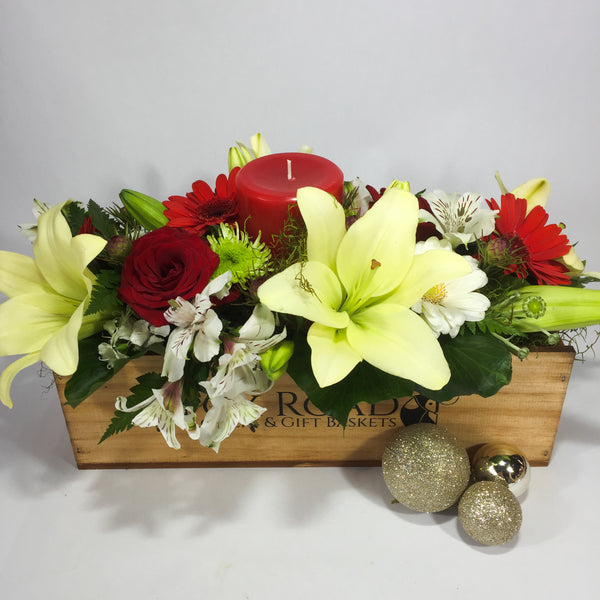 Christmas candle flowers with lilies and roses