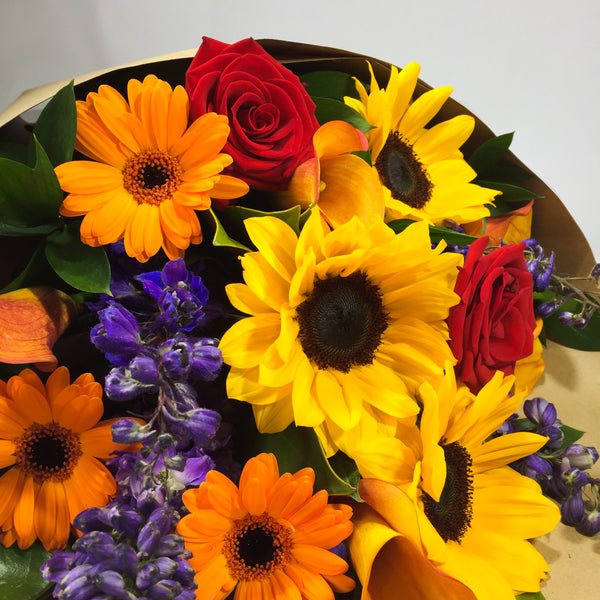 Porirua florist holding yellow Sunflowers and gerberas