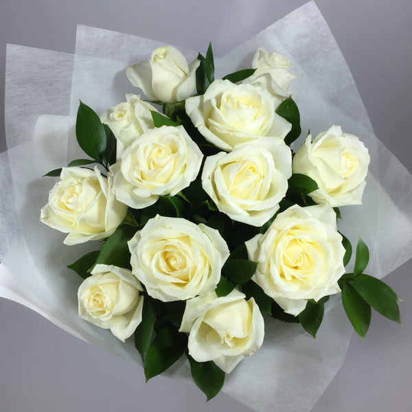 White roses by the dozen from this Wellington florist