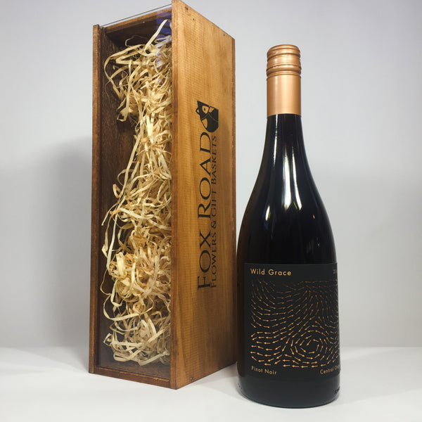 Wild Grace pinot noir outside a wooden gift crate