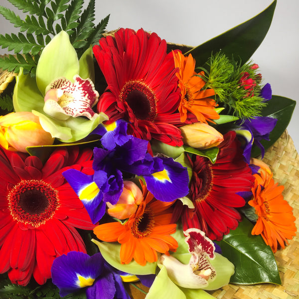 Close up of bright gerberas and daffodils.