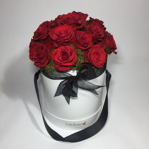 Red roses in a birthday flower hat box