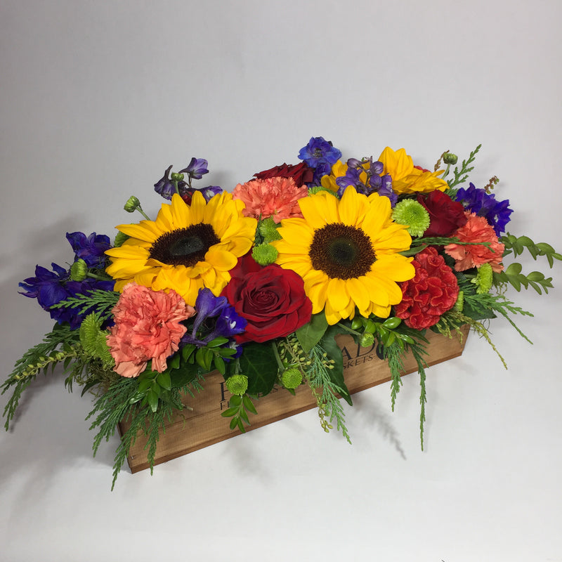 branded wooden crate with flowers