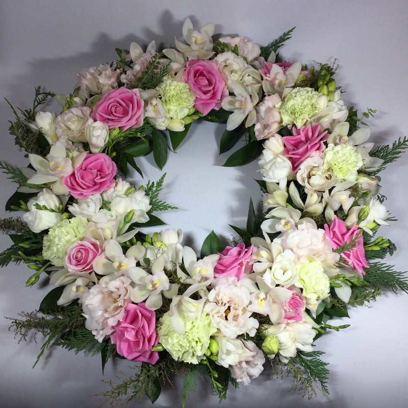 memorial wreath with pink and white flowers