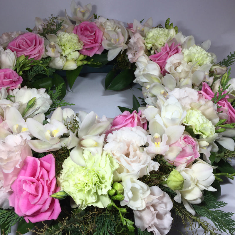 close up of wreath with funeral flowers