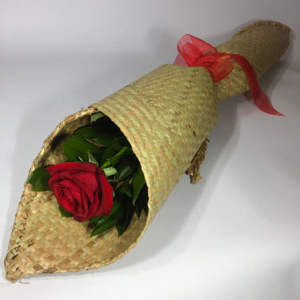 Red rose wrapped in traditional flax