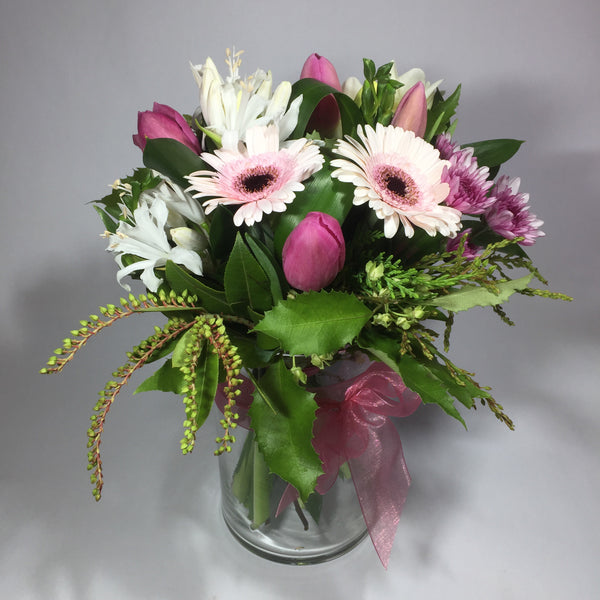 vase flowers with gerberas, tulips and greenery
