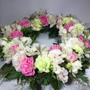 Stunning flower wreath with greenery for memorial service