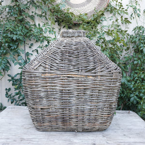 large clay and wicker decorative vessel like a primitive fishing basket