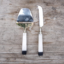 Load image into Gallery viewer, Set includes one cheese knife and one cheese plane made of stainless steel with white marble handles tipped in black at the ends