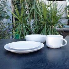 "Load image into Gallery viewer, White stoneware dinner service set Service for 1 this set includes: a 10.5"" dinner plate, an 8.25"" salad plate, a 32 Oz/7.5"" dinner bowl, and a 22 Oz oversized mug"