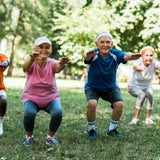 Elderly adults do exercises in the park.